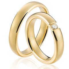 Betaalbare trouwringen met een diamant in het 24 karaat geelgoud