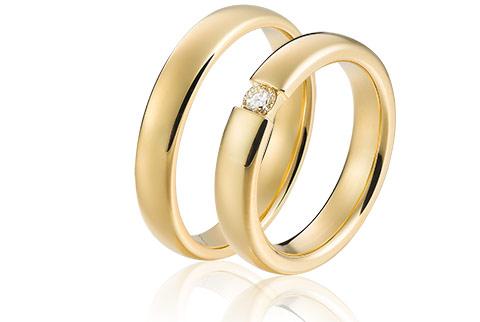 Klassieke trouwringen van 18 krt goud met diamant