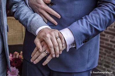 Gay trouwringen van zirkonium en goud met diamant