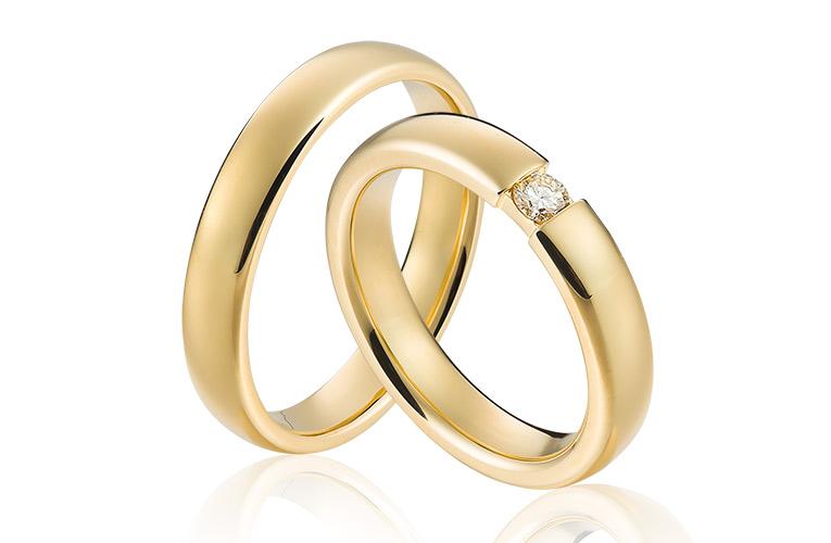 tijdloze trouwringen met briljant in goud