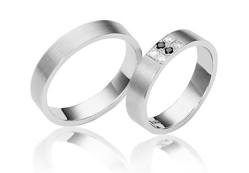 witten en zwarte briljanten in ringen van platinum