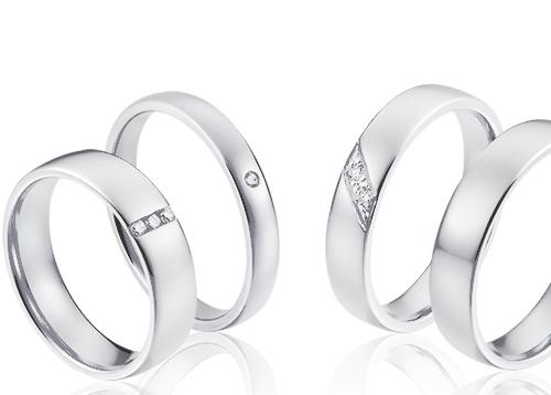 Klassieke 14 karaat witgouden trouwringen met diamanten