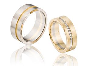 14 krt bicolor trouwringen met diamanten in de damesring